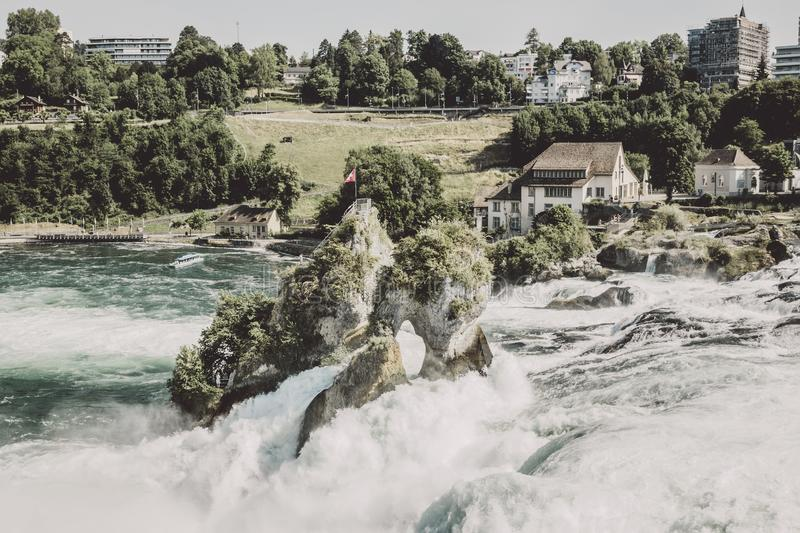 View from castle Laufen on Rhine Falls is the largest waterfall in Schaffhaus. En, Switzerland. Summer landscape, sunshine weather, blue sky and sunny day stock image