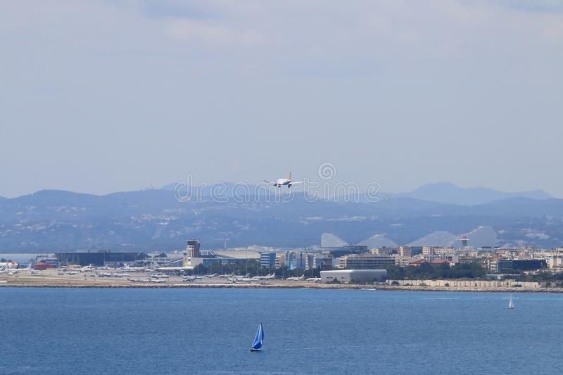 Airplane approaches Nice airport in France royalty free stock image
