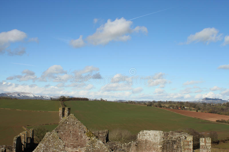 View from the castle ruins. Open countryside view through from the stone castle ruin stock photo