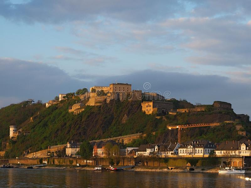 A view of the castle at sunset-Koblenz is a historic city with tourist sites such as medieval churches. Koblenz is a German city located on the confluence of the royalty free stock photos