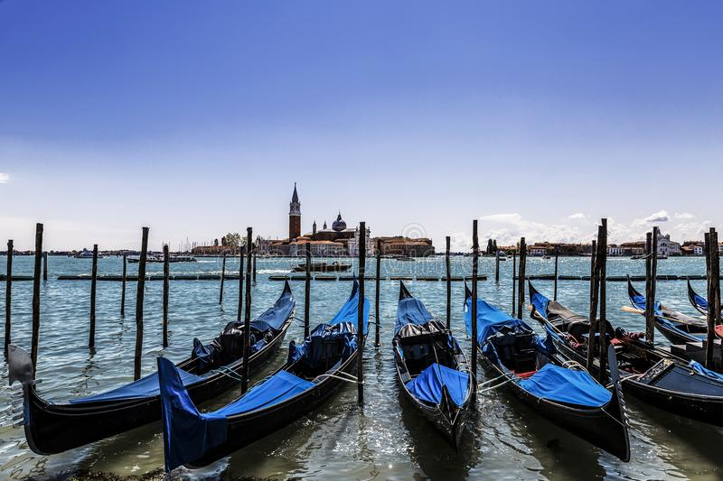 A view of the Cathedral of San Giorgio Maggiore, Venice lagoon and gondolas from the Piazza San Marco, Venice. Italy royalty free stock photo