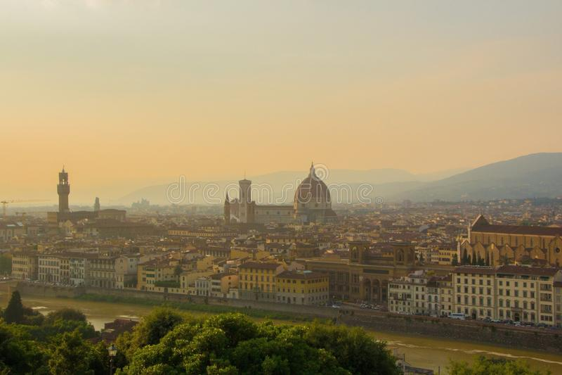 View of the Cathedral of Santa Maria del Fiore Duomo, Basilica of Santa Croce, and Arnolfo tower of Palazzo Vecchio. royalty free stock photography