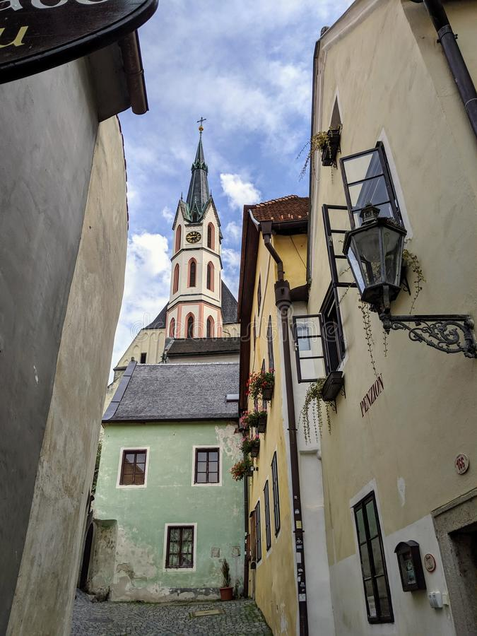 View of the Cathedral of St. Vitus through a medieval street in Cesky Krumlov royalty free stock photography