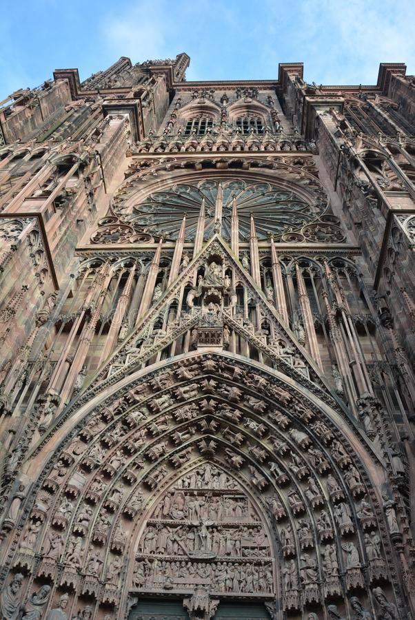 View of the Cathedral, Strasbourg. A view looking upwards, capturing all the impressive detail as you reach to the blue sky. Strasbourg Cathedral de Notre-Dame stock images