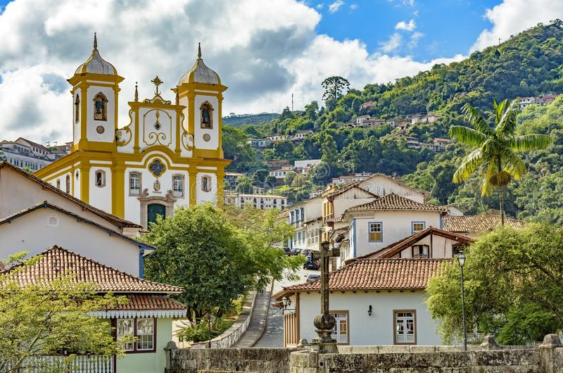 View of the center of the historic Ouro Preto city in Minas Gerais. Brazil with its famous churches and old buildings with hills in background stock photography