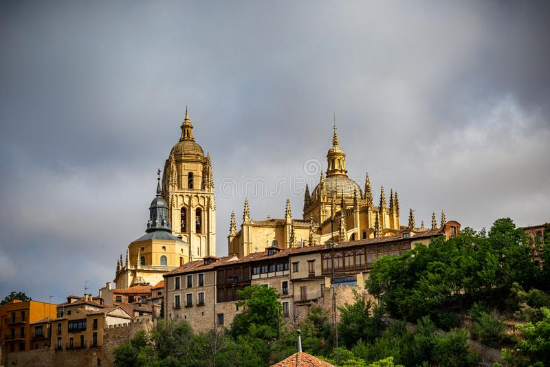 View of the center of Segovia, Spain. View of Segovia with gothic cathedral, typical ancient houses, city wall. Nights, pinnacles and tower. Segovia, Spain royalty free stock photo