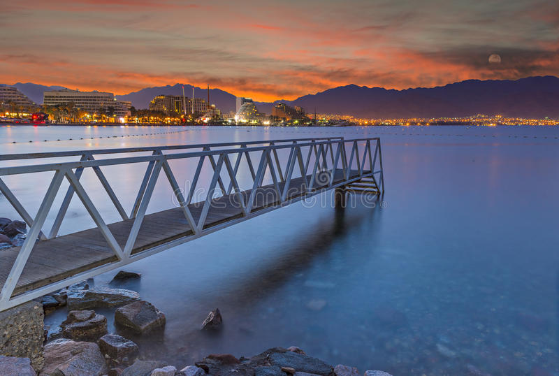 View from central beach of Eilat on the Red Sea. The shot was taken just before sunrise in Eilat - famous resort city in Israel stock image