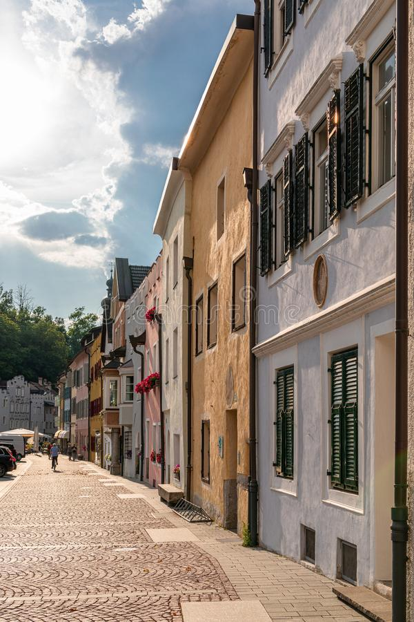 View of the central street of the picturesque Alpine town Bruneck Brunico Trentino-Alto Adige, Italy. Vertical photo royalty free stock image