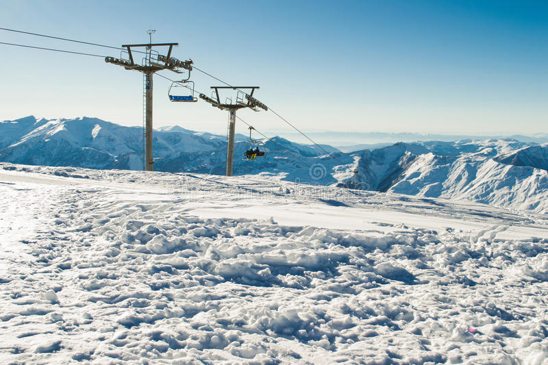 View chairlift at ski resort with mountain range on background. Extreme sport. Active holiday. Free time, travel concept. Copy spa. Photo of the View chairlift royalty free stock photo