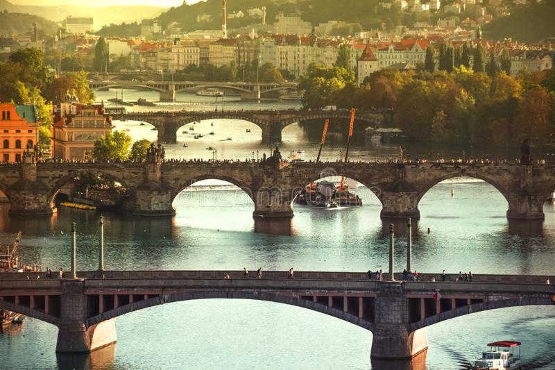 View of Charles bridge and the old town of Prague in Czech Republic, at the banks of Vltava River under the sunset royalty free stock photos