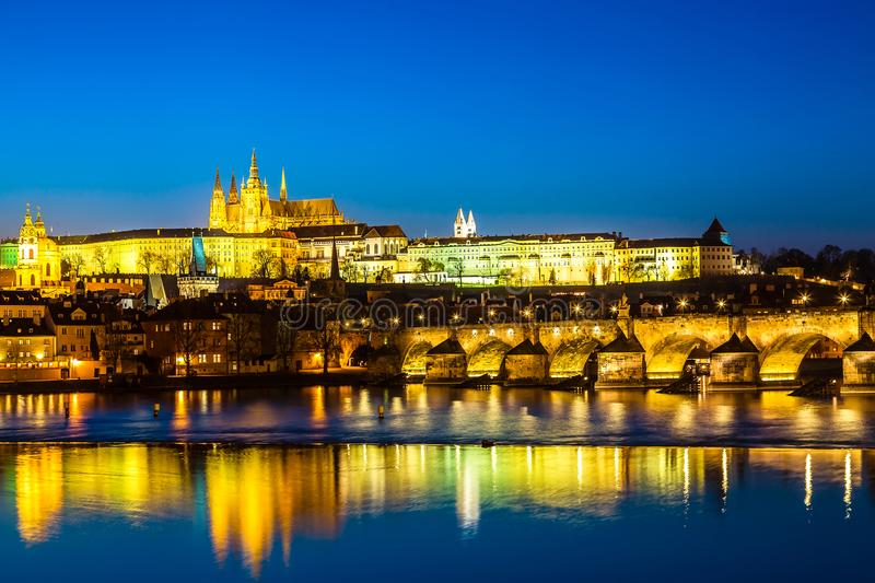 View of Charles Bridge, Prague Castle and Vltava river in Prague, Czech Republic during blue hour twilight sunset royalty free stock photography