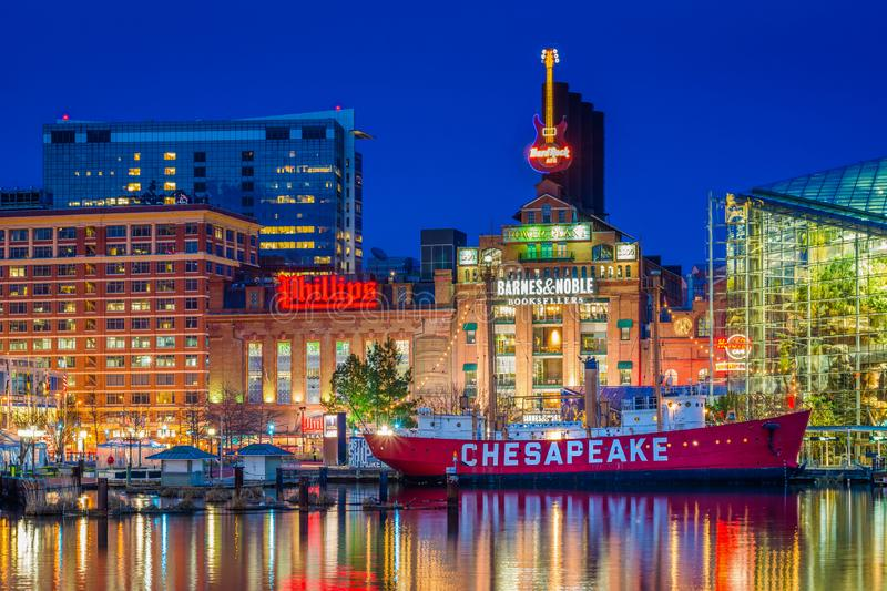 View of the Chesapeake Lightship and Power Plant at night, at the Inner Harbor in Baltimore, Maryland royalty free stock photography