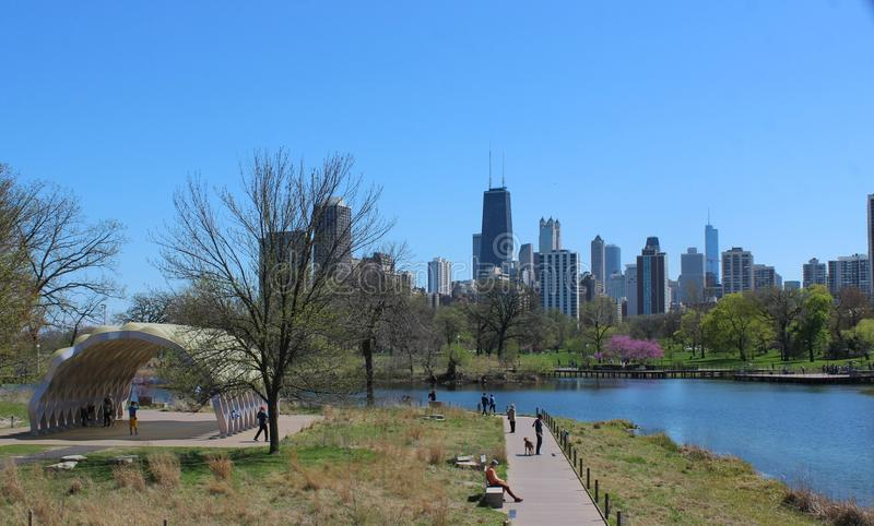 View of Chicago Skyline from Lincoln Park, with South Pond Pavilion royalty free stock photography