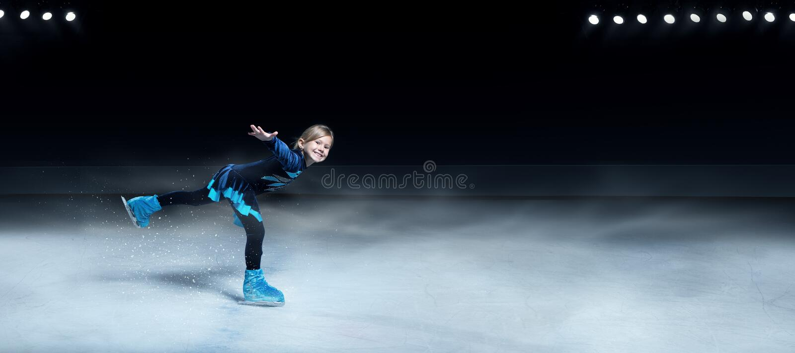 Figure skater on dark ice arena background stock photo