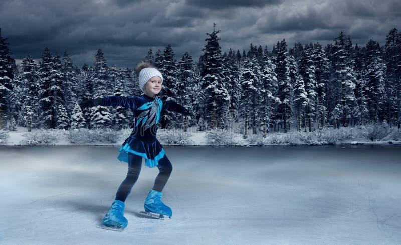 Figure skater on winter lake  background royalty free stock image