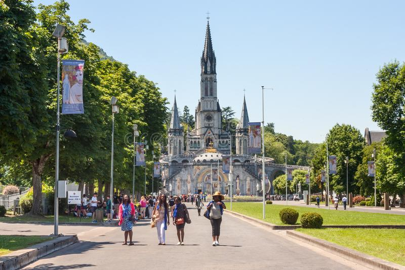 View of the Christian pilgrims and the Sanctuary of Our Lady of Lourdes royalty free stock photo