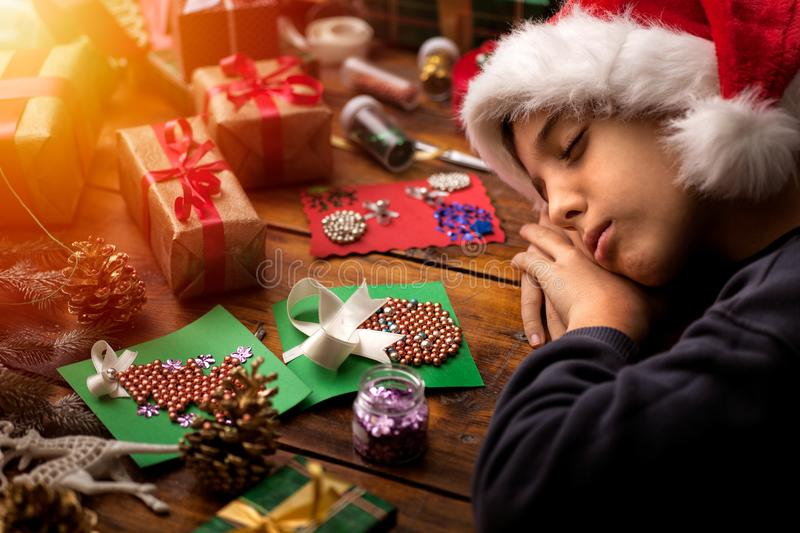 Concept of Merry Christmas and Happy Holidays!. View of the Christmas presents with young boy stock photos