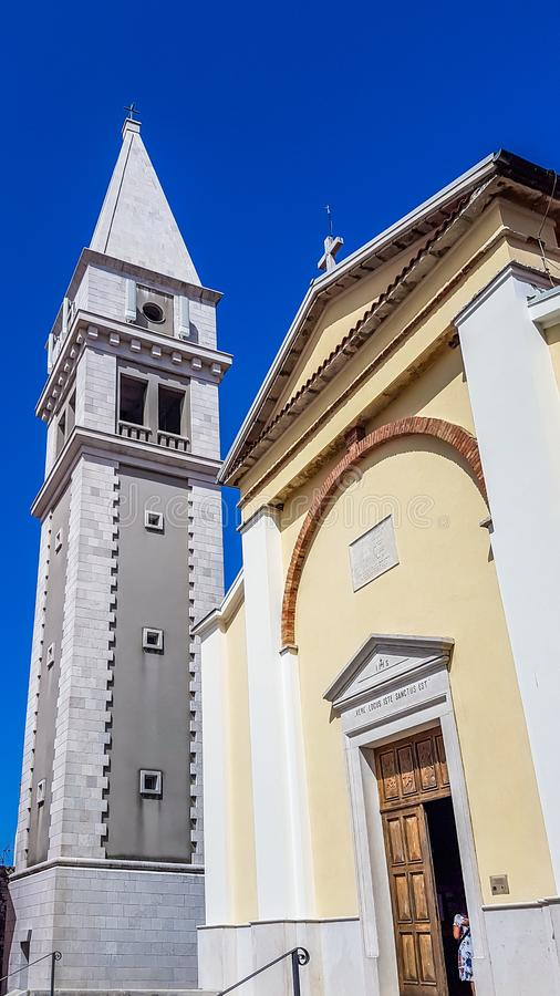 Vrsar - Church and bell tower in the city centre royalty free stock image