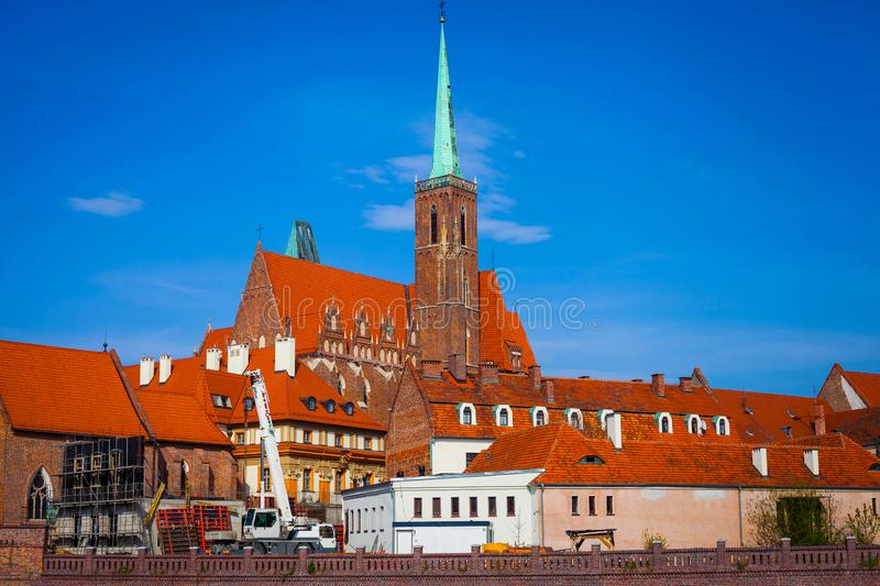 View on Church of the Holy Cross in Ostrow Tumski. Side view on a Gothic church of the Holy Cross on Ostrow Tumski Cathedral Island in Wroclaw stock photography