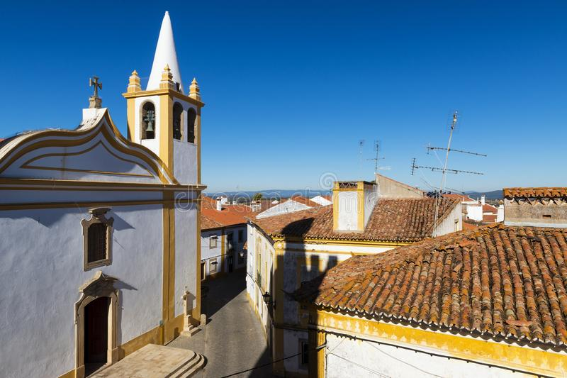 View of a church and houses in the traditional village of Nisa in Alentejo, Portugal. Concept for travel in Portugal and visit Portugal stock image