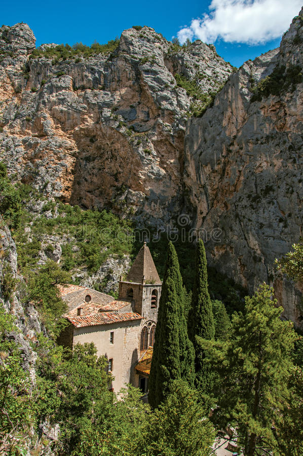 View of the church Notre-Dame de Beauvoir amid the cliffs. royalty free stock image