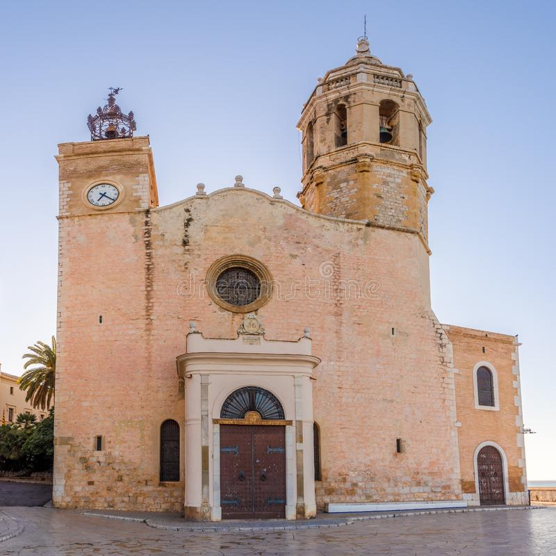 View at the Church of Saint Bartolomeus and Santa Tecla in the streets of Sitges in Spain stock images