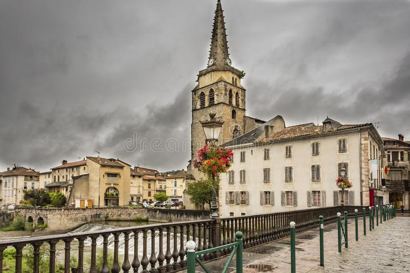 View of the Church of Saint Girons. Ariege France. View of the Church from the old bridge over the river Salat in the village Saint Girons. Ariege France royalty free stock photo