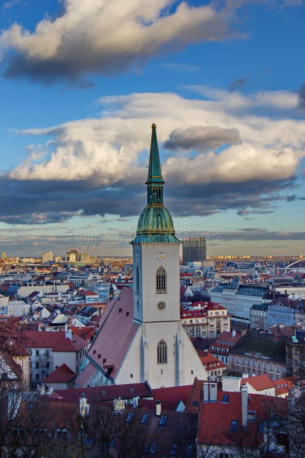 View on Church of saint Martin and city of Bratislava in the evening, Slovakia royalty free stock image
