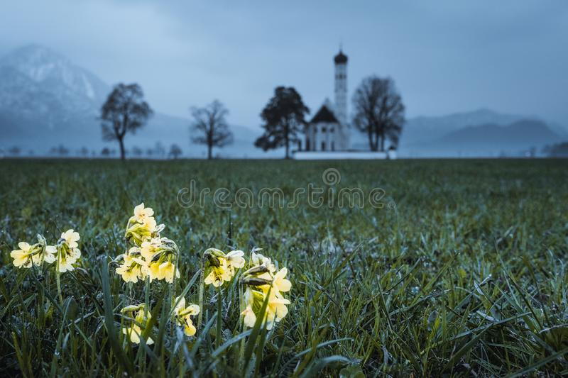 View at the church st. colloman. In the front of the picture you can see the St. Colloman Church. At clear days you can also see on the left side the castle Neu royalty free stock image