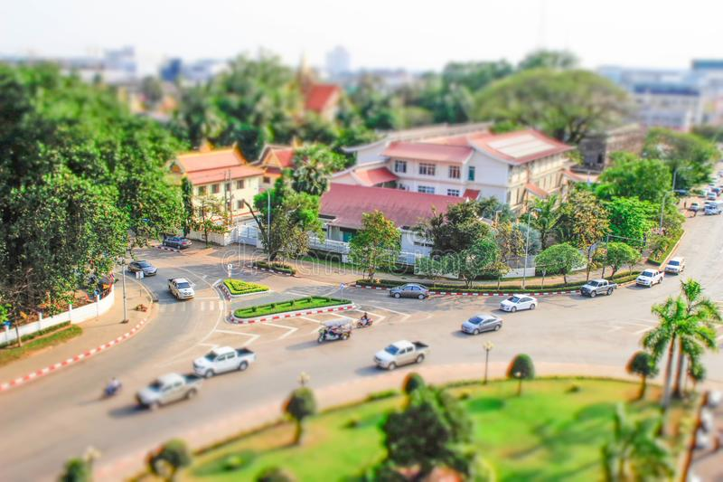A view of the city from above from the central gates in tiltshift style royalty free stock photography