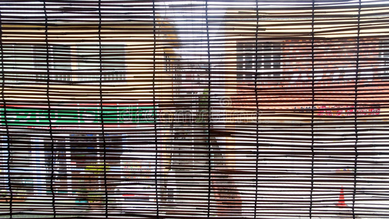 View of the city through bamboo blinds. In ryoukan stock image