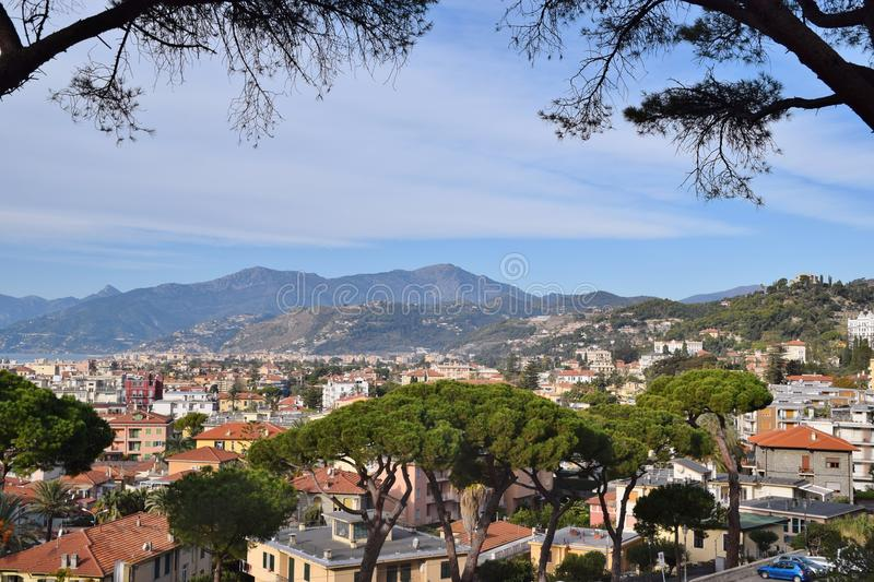 View of the city of Bordighera. In Italy. In the background the mountains and the sea stock photo
