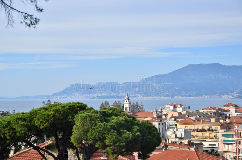 View of the city of Bordighera. In Italy. In the background the mountains and the sea royalty free stock photos