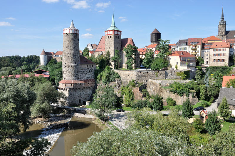 View of city center, bautzen. View of city center with ancient fortifications and city walls that surround houses, church, towers and lean over the river stock photos