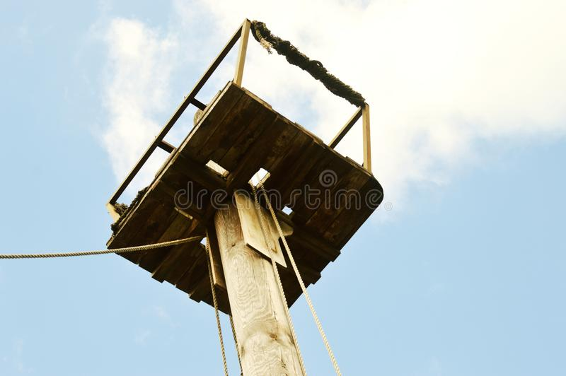 Wooden mast of the old ship in the blue sky. royalty free stock images