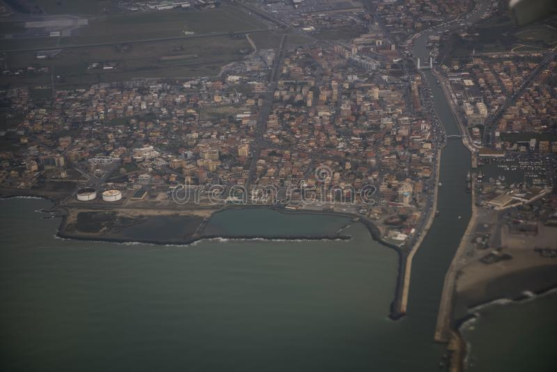 View of the city of Fiumicino from the aircraft royalty free stock photo