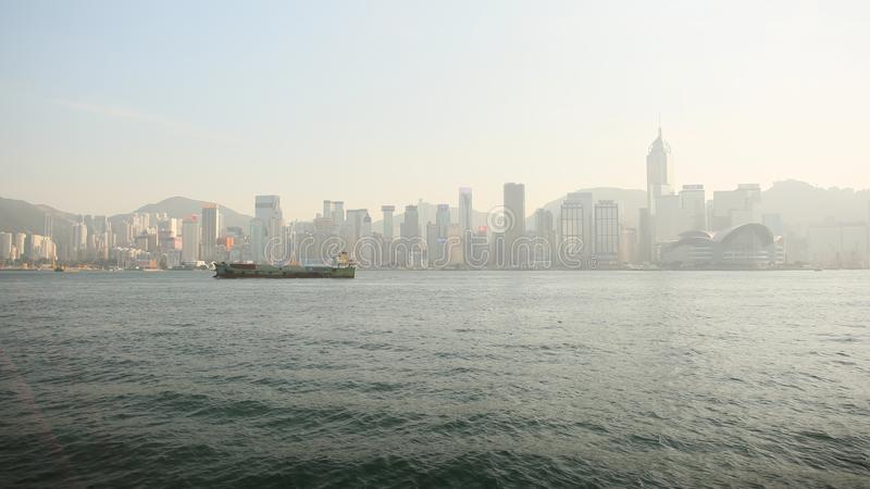 Hong Kong, China - January 1, 2016: View of the city of Hong Kong and the sea with a floating ship. Panorama of the city stock photography