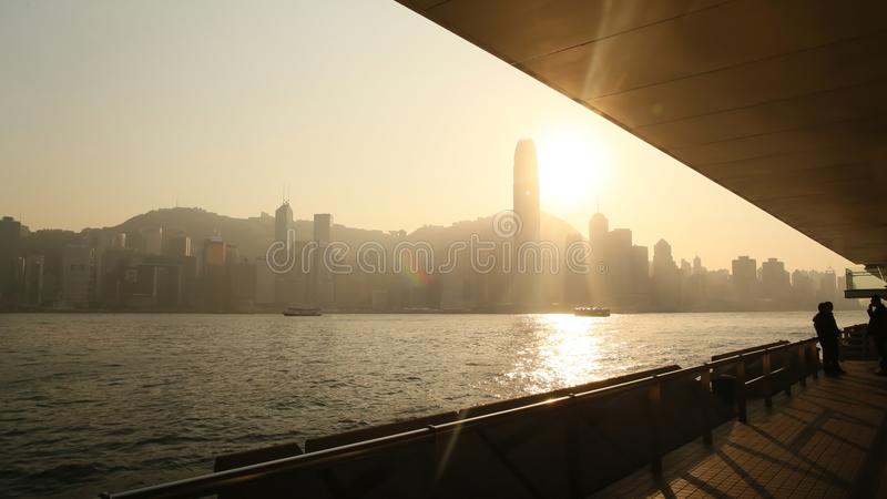 Hong Kong, China - January 1, 2016: View of the city of Hong Kong and the sea in the rays of the sunset from the harbor royalty free stock photo