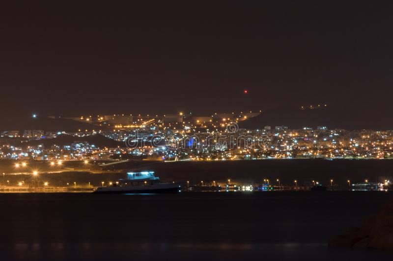 View of city light of Eilat in Israel from Aqaba in Jordan at night royalty free stock photos