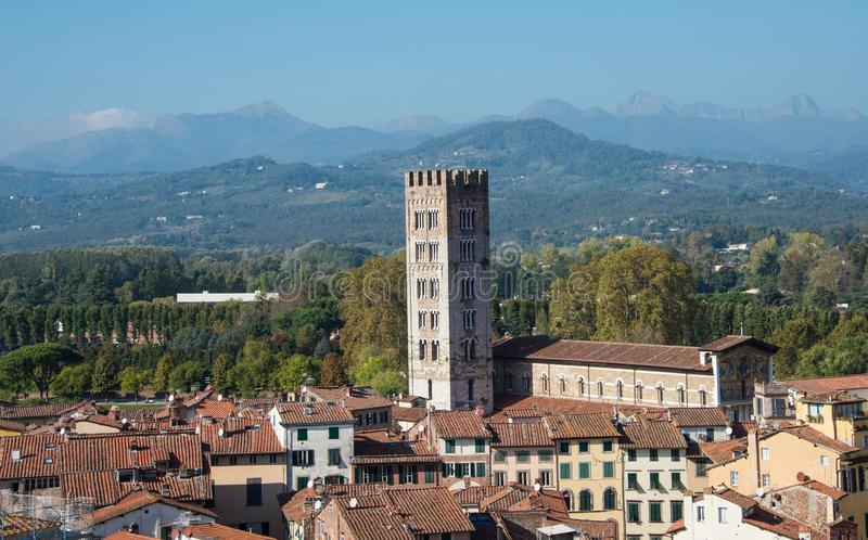 A view of the city of Lucca in a bright beautiful day and Chiesa di San Salvatore stock photos