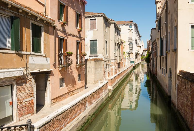 View of the city narrow street, bridge and canal in Venice, Italy royalty free stock image