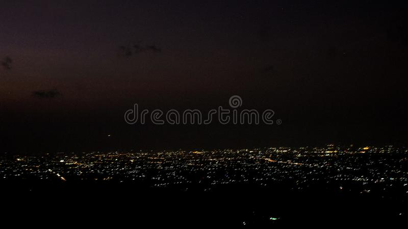 View of the city at night from the hill royalty free stock photography