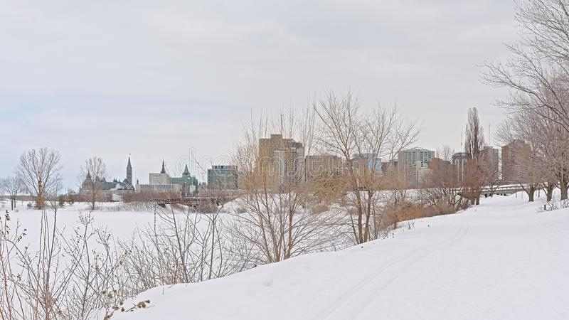 View on the city of Ottawa from the Sjam winter hiking trail along Ottawa river. royalty free stock image