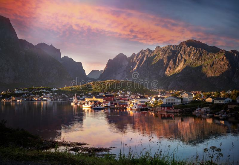 View of the city of Reine on the Lofoten islands, a beautiful bright landscape, white and red houses on a background of rocks at stock image