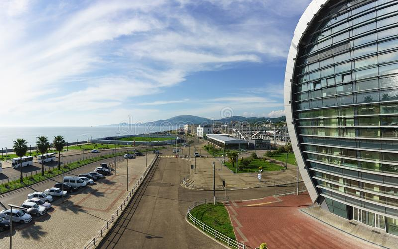 View of the city and the sea from the stairs of the modern passenger railway station. Sunny day. In late spring stock image