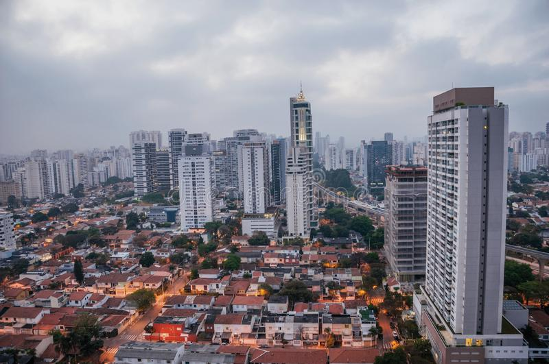 View of the city skyline in the early morning light with houses and buildings under cloudy skies in the city of São Paulo. The gigantic city, famous for its royalty free stock photo