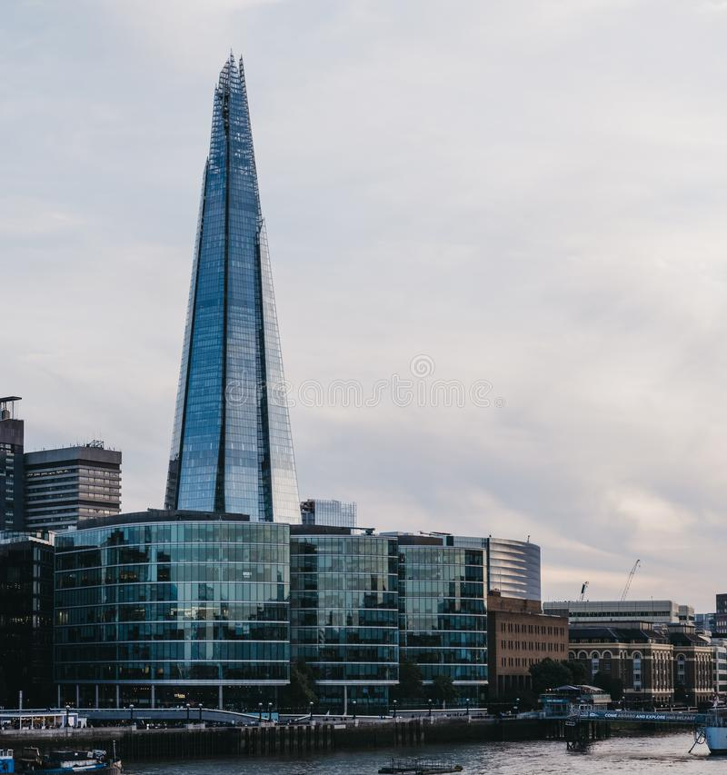 View of city skyline and The Shard, London, UK, from the opposite side of the River Thames during blue hour royalty free stock photo