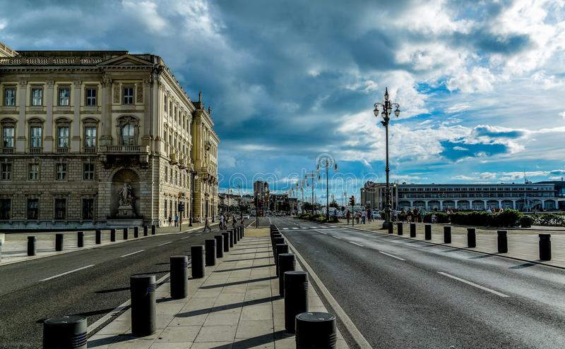 View of City Street Against Cloudy Sky royalty free stock photography