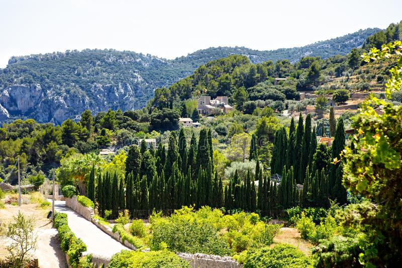 View on city Valldemossa with traditional flower decoration, famous old mediterranean village of Majorca. Balearic royalty free stock photography