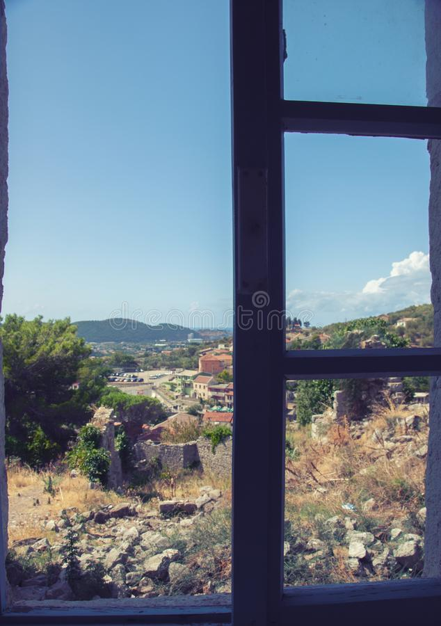View of the city from the window of the building in the fortress of the old bar, Montenegro. royalty free stock photography